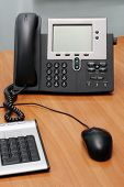 Modern digital phone on office table