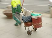 Scavenger Cleans On The Street.his Working Equipment Carries On The Carriage. poster