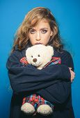 Fashion Girl With Glamour Makeup Hold Toy Bear. Woman With Fashion Makeup And Long Curly Hair. Fashi poster