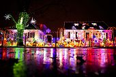 Shiny Christmas Decorations And Lights At Night. Glow Christmas Display Outside poster