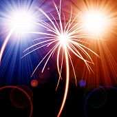 stock photo of firework display  - Colorful fireworks in red and blue on a dark background - JPG