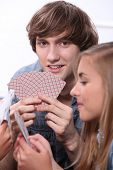 Young people playing cards