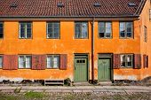 Facade Of Building With Old Window Frames And Wooden Doors On Old Street Of Denmark. Historical Colo poster
