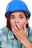Shocked woman wearing a hard hat