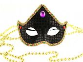 Black carnival mask with gold pearls isolated on a white background