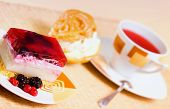 Tasty cake with cup of tea