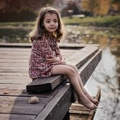 Sad crying girl on the countryside poster