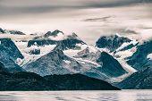 Glacier Bay National Park, Alaska, USA. Alaska scenic cruise travel view of snow capped mountains at poster