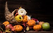 A Thanksgiving Holiday Decorative Cornucopia With Pumpkins, Squash, Leaves Etc poster