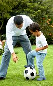 foto of happy kids  - family lifestyle portrait of a dad with his son playing football - JPG
