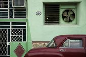 Facade and oldtimer in Old Havana