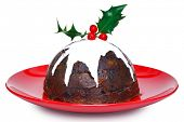 Photo of a steamed Christmas pudding with cream and holly on top isolated on a white background. Sli