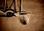 Action shot of basketball going through basketball hoop and net