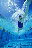 foto of gush  - Female swimmer gushing through water in pool - JPG