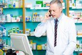 Portrait of a pharmacist talking on the phone