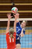 KAPOSVAR, HUNGARY - APRIL 22: Zsanett Pinter (in blue) in action at the Hungarian I. League volleyba