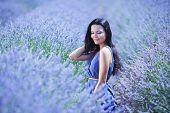 Woman sitting on a lavender field