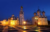 Kremlin square in night with Alexander Nevsky Church, Belfry Sophia Cathedral, Holy Resurrection Cat