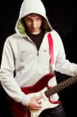 picture of stratocaster  - Man with red electric guitar - JPG