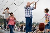 VLADIVOSTOK, RUSSIA - AUGUST 11: People celebrate the opening of the largest cable bridge across the