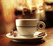 Coffee cup on abstract background