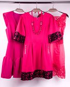 The pink dress on a hanger in the closet