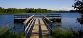 Fishing Pier In Blue Lake