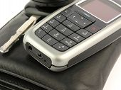 stock photo of gizmo  - mobile phone on the wallet and key - JPG