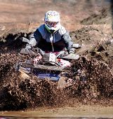 picture of mud  - The driver ATV demonstrates the overcoming of mud obstacle - JPG