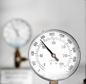 stock photo of vacuum pump  - Industrial gas gauge closeup photo with white background - JPG