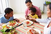 stock photo of 11 year old  - Family Eating Meal Together At Home - JPG