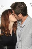 LOS ANGELES - JUN 5: Alyson Hannigan and Alexis Denisof kissing at the screening of Lionsgate and Roadside Attractions' 'Much Ado About Nothing' on June 5, 2013 in Los Angeles, California