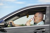 Man eating ice cream while sitting in car