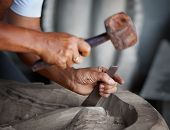Hands Woodcarver With The Tools