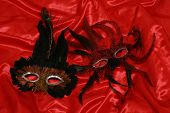 Two Masks On Red Silk