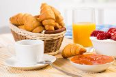 foto of continental food  - continental breakfast: coffee, strawberry with cream, croissant