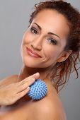 Beautiful middleaged caucasian woman massages herself
