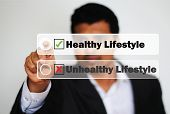 stock photo of unhealthy lifestyle  - Male Professional Choosing healthy lifestyle vs unhealthy lifestyle - JPG