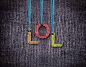 image of lol  - Lol Letters hanging strings with blue sackcloth background - JPG