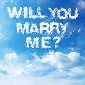 stock photo of marriage proposal  - Cloud to cloud with letters written marriage proposal - JPG