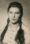 POLAND, CIRCA 1940: Vintage portrait of young woman with braids