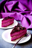 Two Pieces Of Purple Cake Souffle Black Currants