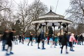 LONDON, UK - DECEMBER 13, 2012: People ice skate at the Winter Wonderland ice rink in Hyde Park.
