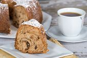 stock photo of prunes  - Slice of homemade bundt cake with prunes and spices - JPG