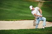image of swing  - golf shot from sand bunker golfer hitting ball from hazard - JPG