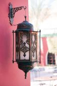 Old Bronze Candle Lamp On Palace Wall