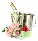 Romantic still life with champagne, strawberry and pink roses, isolated on white