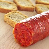 sobrassada, a spreadable sausage typical of Mallorca, Balearic Islands, Spain, on a wooden surface w