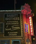 A Babbitt Brothers Neon Sign At Night