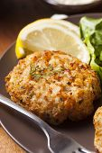 stock photo of crab-cakes  - Organic Homemade Crab Cakes with Lemon and Tartar Sauce